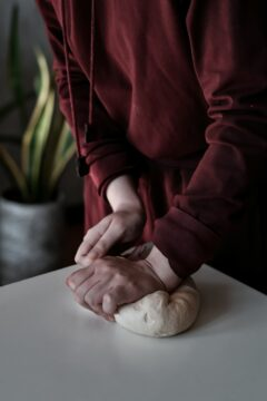 Person with dough.